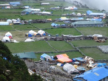 Valley floor in Nepal showing temporary dwellings